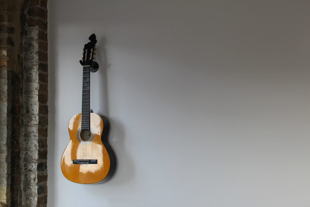 The guitar can be hung on the wall