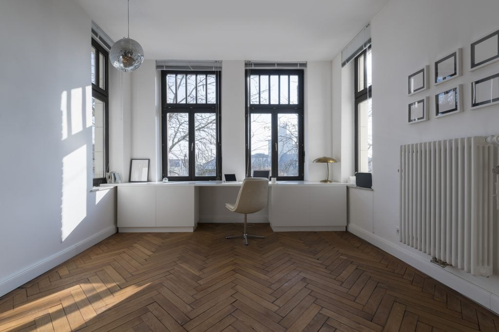 Simply furnished hose room with a white desk spanning the entire front short side